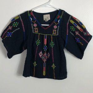 Girls embroidered shirt.